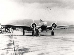 Amelia Earhart arrives at Wheeler Field, Oahu, aboard her twin engine Lockheed Electra on the first leg of her east to west trip around the world flight, March 18, 1937.